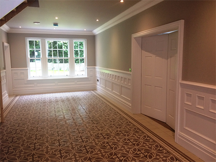 Large entrance hall with made to order beaded wall panelling showing different height and detail underneath window Made in Britain for a home in cheshire