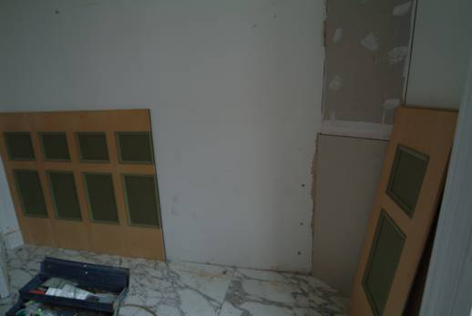 bathroom wall panels being installed by wall panelling ltd