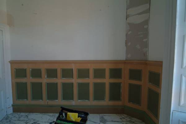 pictures showing bathroom wall panelling being installed by wall panelling experts