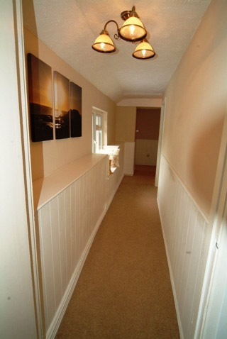 tongue and groove wall panelling in a landing area by wall panelling experts the secret garden south wales sykes cottages