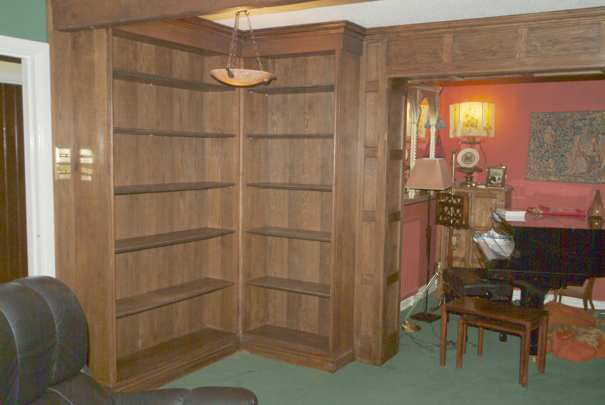 oak wall panelling with matching bookcases by wall panelling experts cheshire