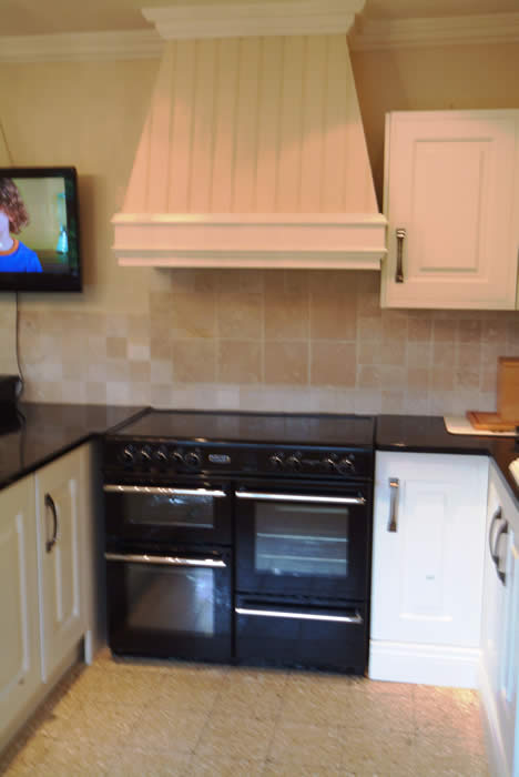 read and bead panelling for character over cookers in the kitchen