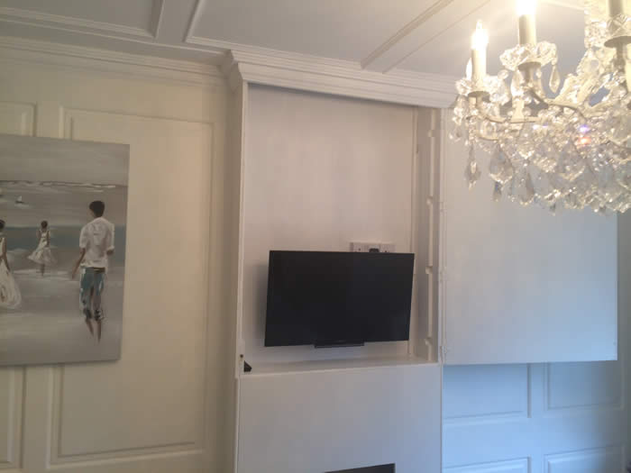 false fireplace with secret door and panelling to hide unsightly tv