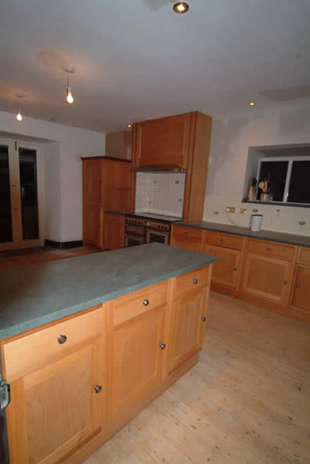wooden kitchen cabinet doors by wall panelling  lake district