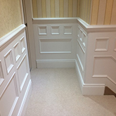 close up of Bevelled back skirting at top of stairs and beaded wall panelling made in Britain