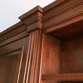 oak panelling with fancy coving detail pillars and bookcases belgravia london finished in a rich dark colour