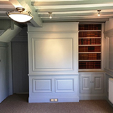 superior wall panelling with built in bookcase